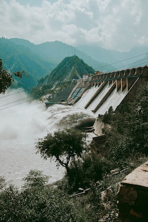 Hydro Electric Dam in Asia. Bitcoin mining in data centers is green energy mix.