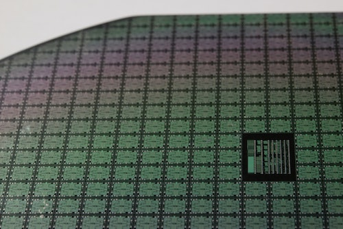"""A macro of a 4"""" square chips with microscopic transistors and circuits. Moore's law is less chips per wafer."""